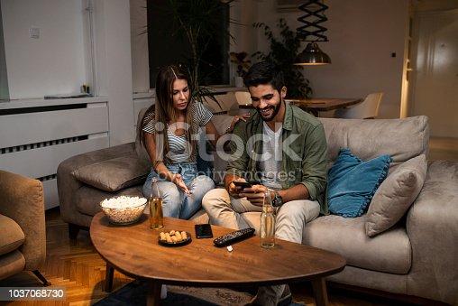 493656728 istock photo Girlfriend snooping her boyfriend 1037068730