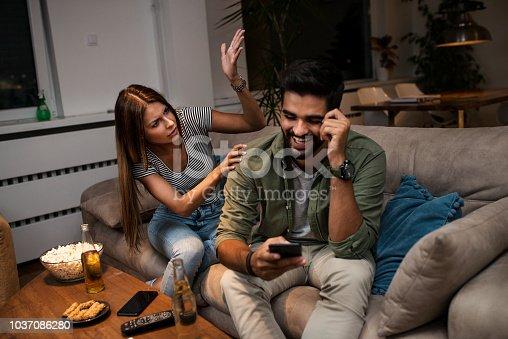 493656728 istock photo Girlfriend snooping her boyfriend 1037086280