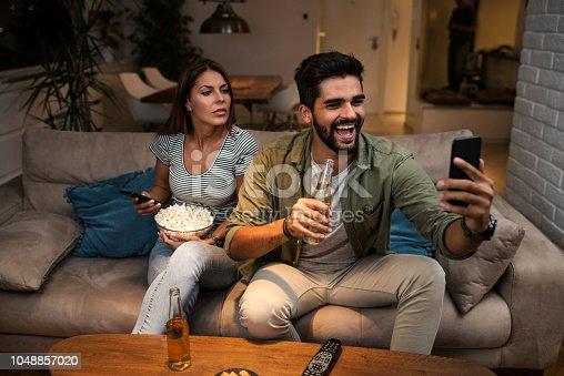 493656728 istock photo Girlfriend snooping her boyfriend 1048857020