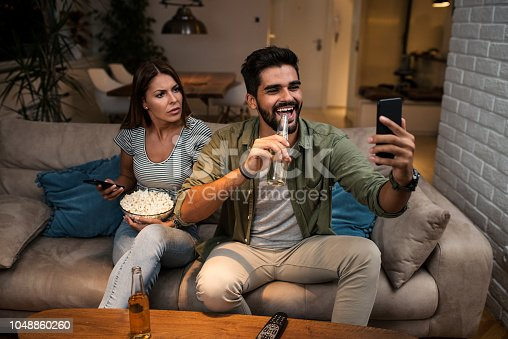 493656728 istock photo Girlfriend snooping her boyfriend 1048860260