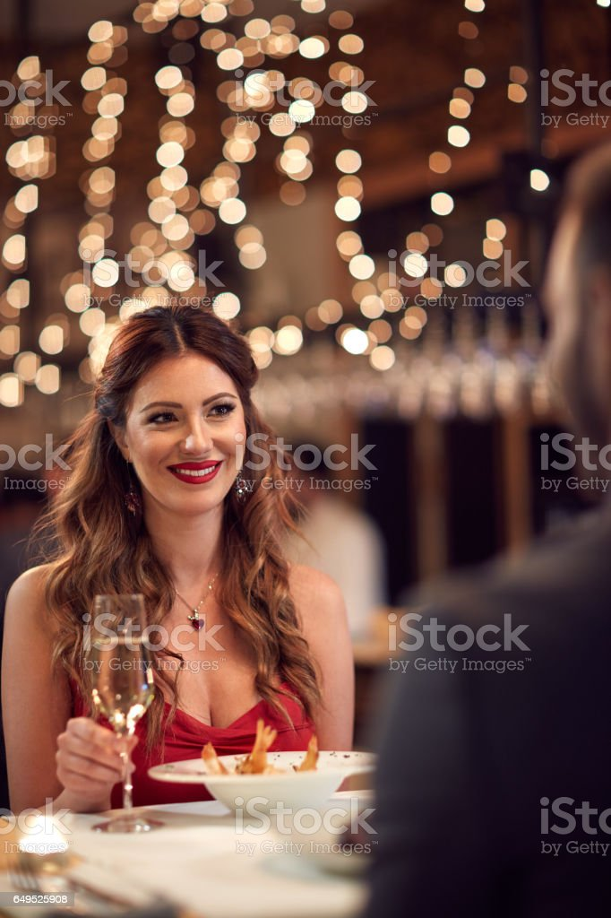 Girlfriend with boyfriend at romantic dinner stock photo