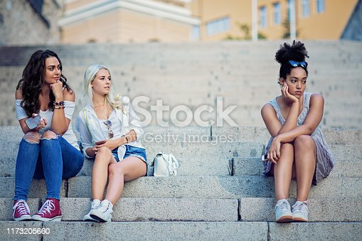 Girlfriends are bullying a girl at the city stairs