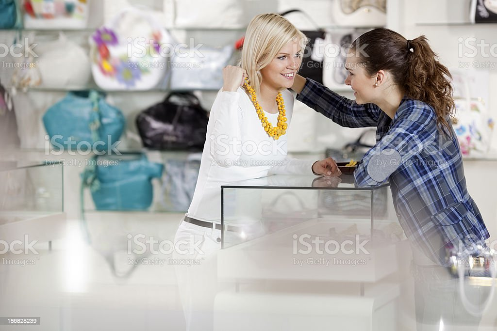 girlfriends are buying fashion accessories jewelry  in   department store royalty-free stock photo