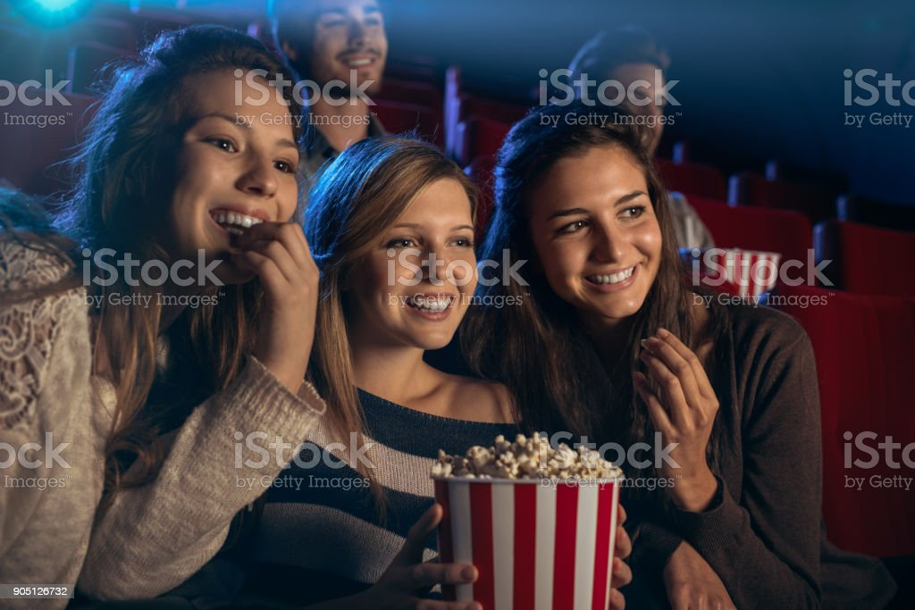 Girlfriends at the cinema stock photo