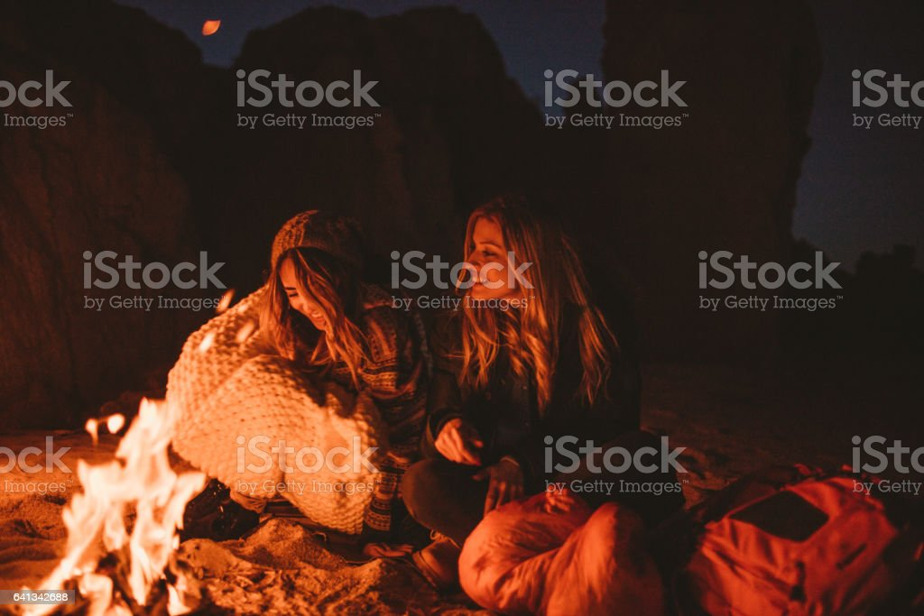 Girlfriends by the campfire stock photo