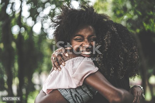 istock Girlfriends Embracing 929728374