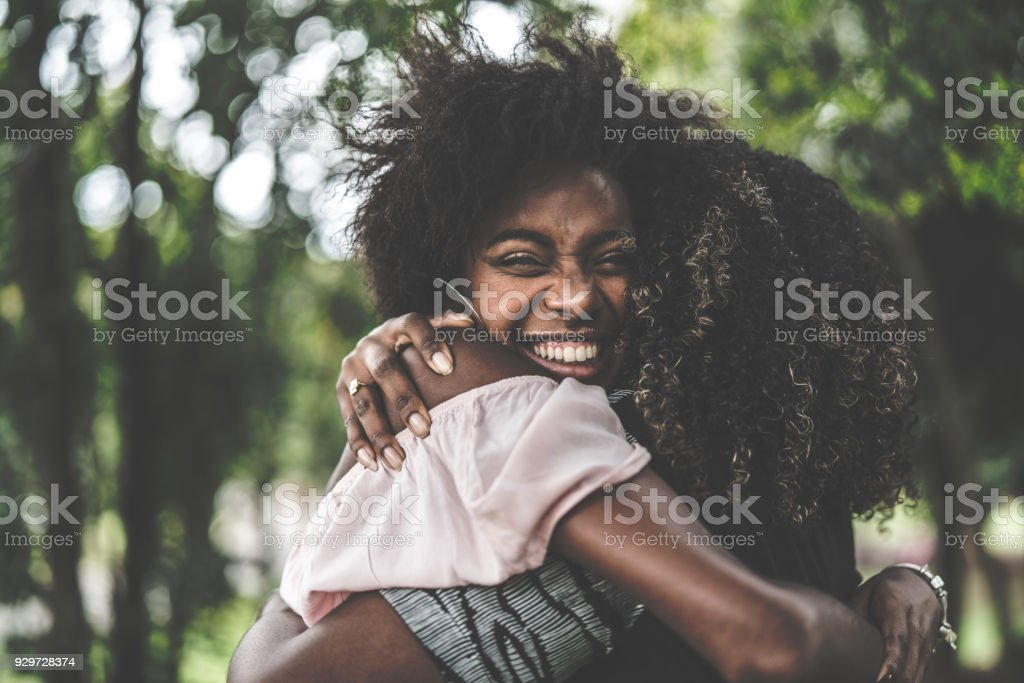 Girlfriends Embracing stock photo
