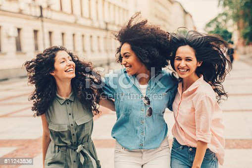 700702502istockphoto Girlfriends hanging out in the city 811243836