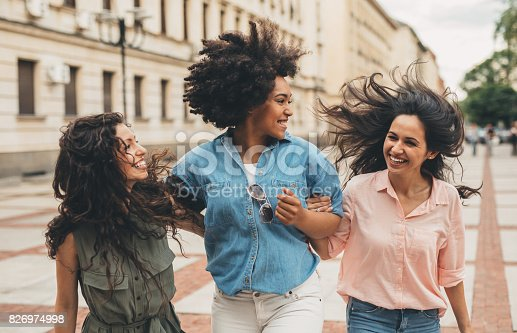 700702502istockphoto Girlfriends hanging out in the city 826974998