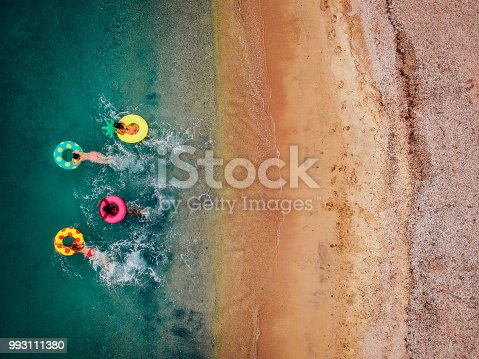 Aerial view of friends relaxing and having fun in the water