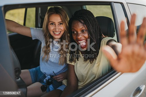 619068028 istock photo Girlfriends having fun on  summer road trip 1258506247