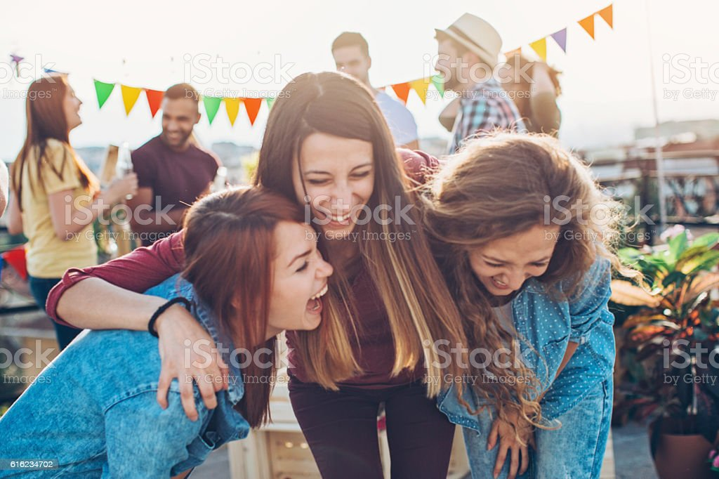Girlfriends laughing out loud on a party stock photo