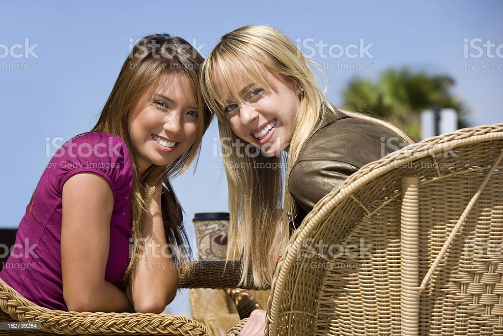 Girlfriends meeting for coffee at a cafe royalty-free stock photo