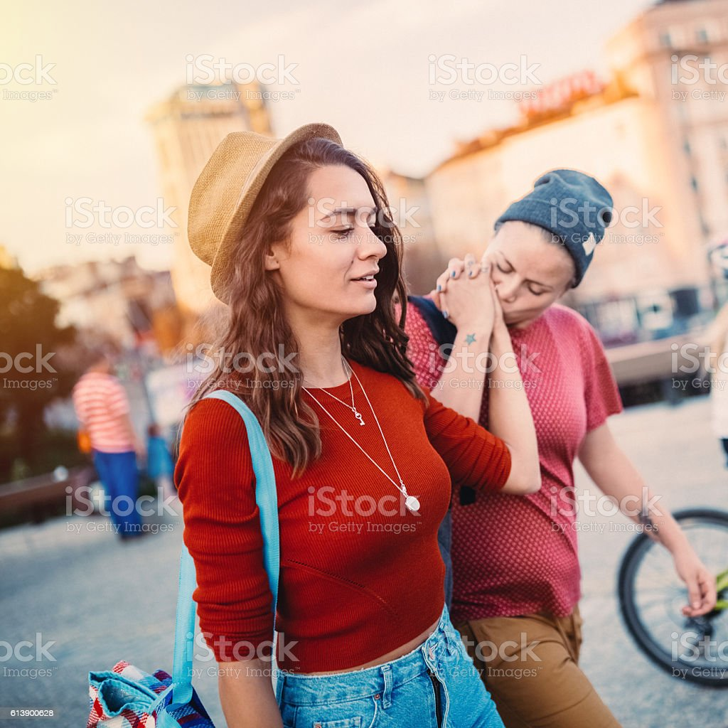 Girlfriends on a leisure walk in the city - Photo