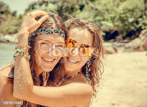 Girlfriends on the tropical  beach