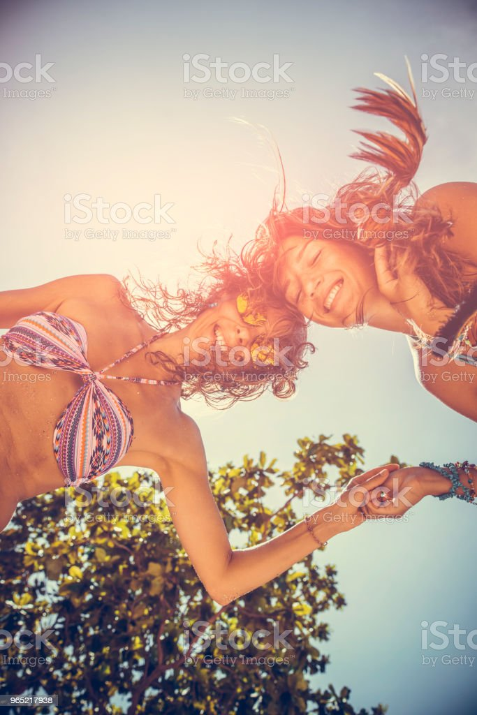 Girlfriends on the beach royalty-free stock photo