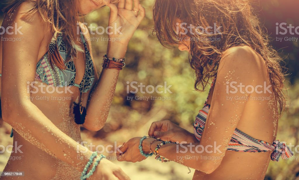 Girlfriends on the beach stock photo
