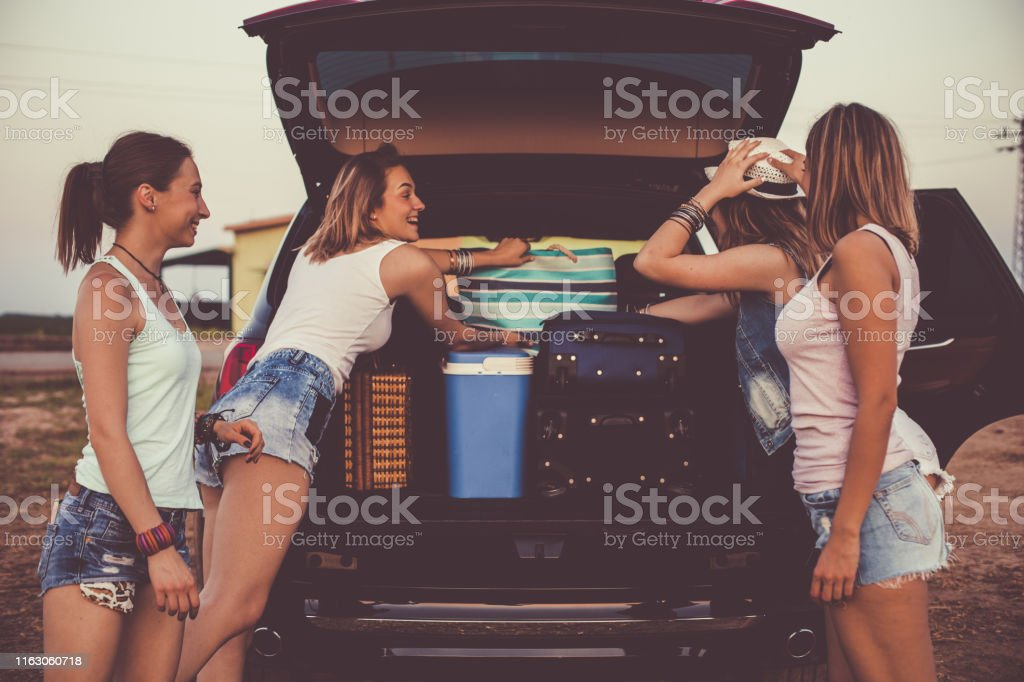 Three quarter length shot of four cheerful young females preparing...