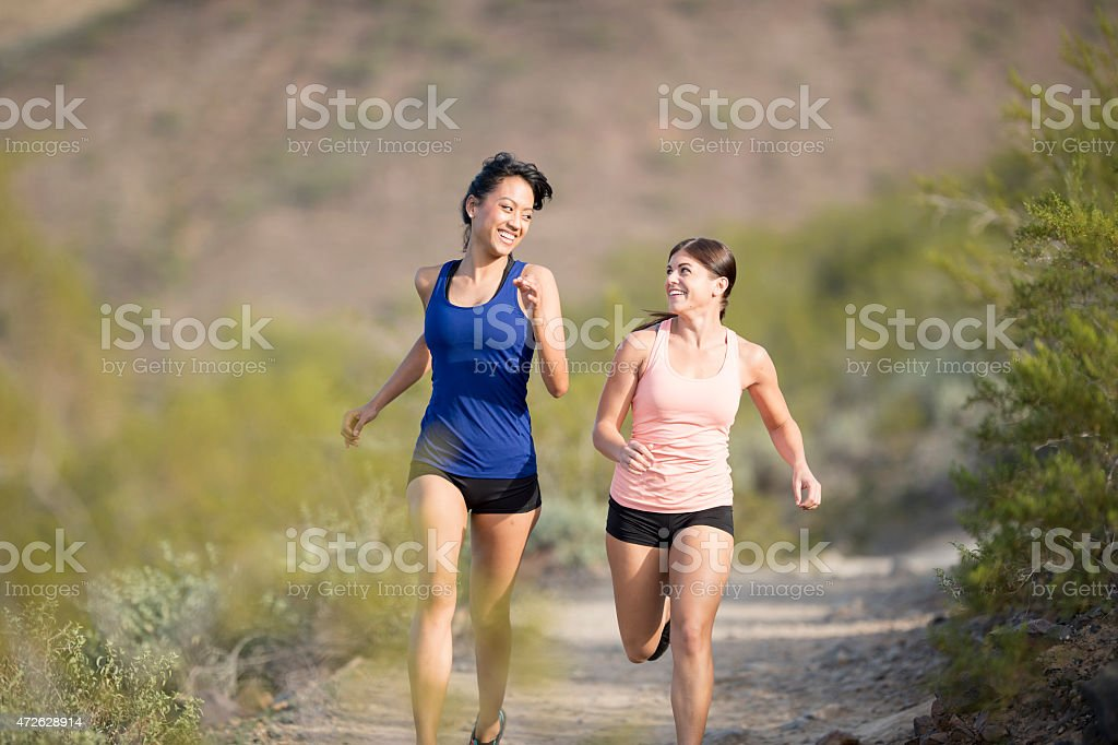 Girlfriends Running Together stock photo