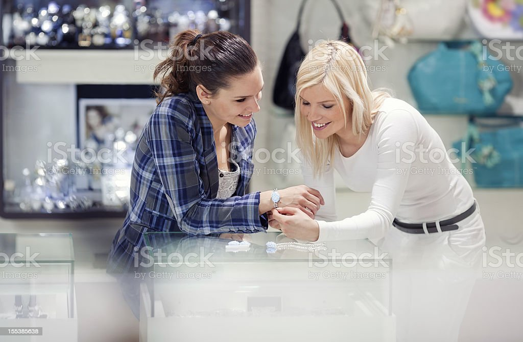 Girlfriends Shopping for Jewelry royalty-free stock photo