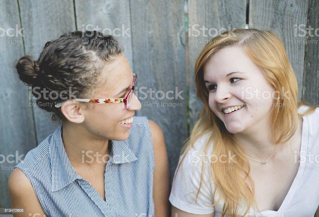Girlfriends smiling stok fotoğrafı