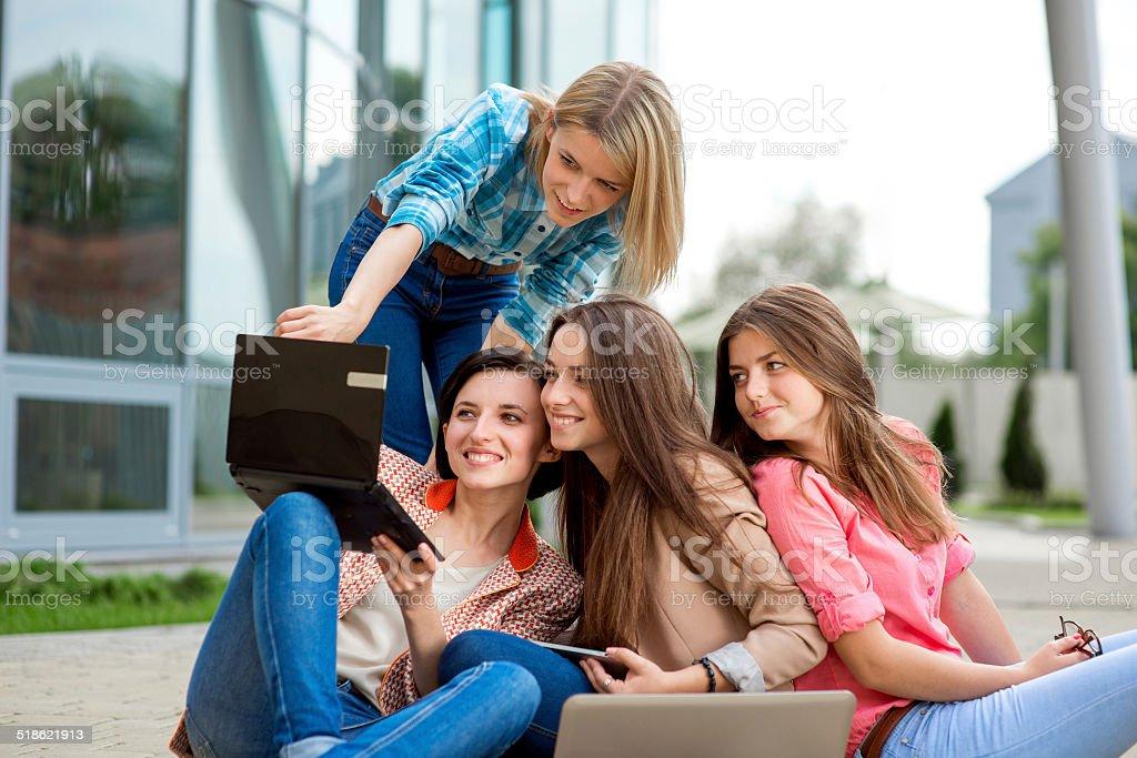 Girlfriends studying and heaving fun stock photo