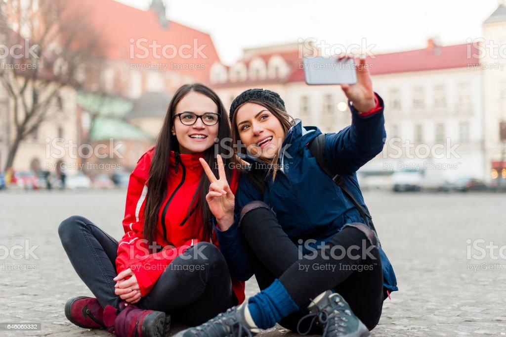 Girlfriends taking a self portret in the city. stock photo