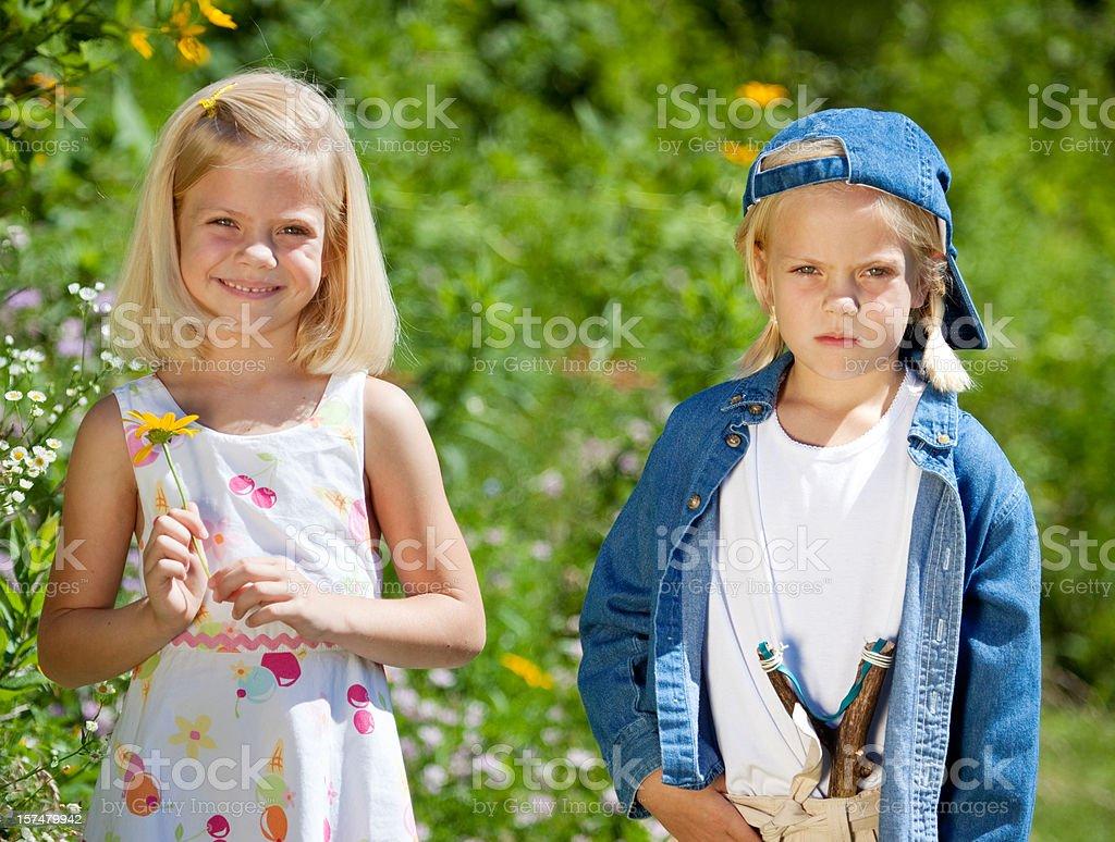 Girlie Girl Vs. Tomboy stock photo