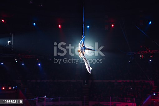 Girl's aerial acrobatics in the Circus