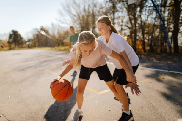 Girls and basketball stock photo