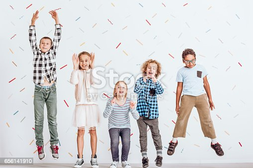 istock Girls and boys jumping 656141910