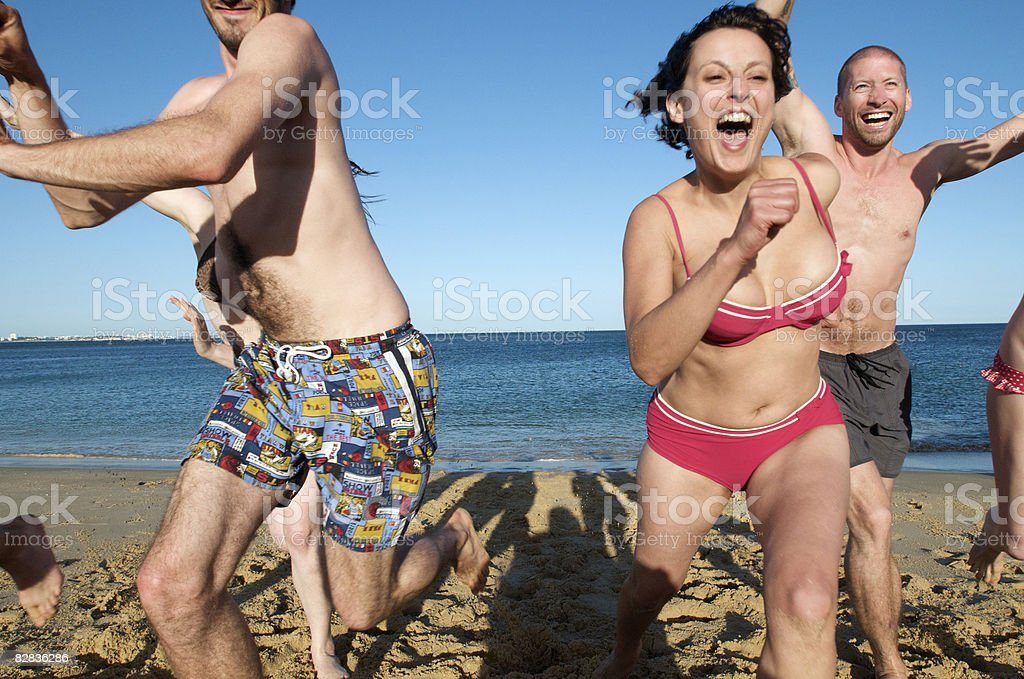 girls and boys racing on the beach foto stock royalty-free