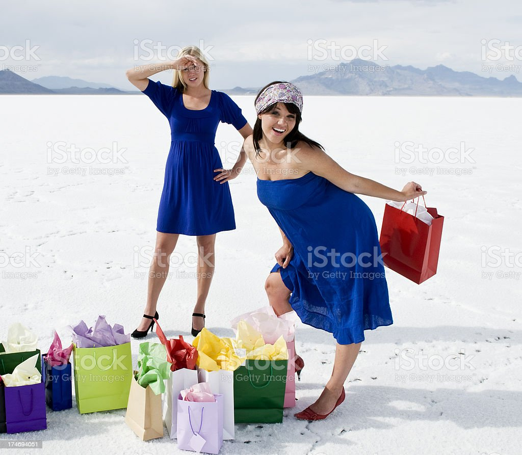 Girls and gift bags stock photo