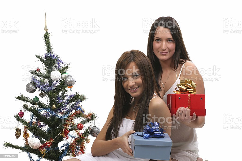 Girls and the tree royalty-free stock photo