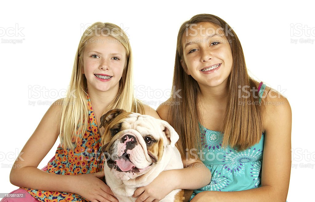 Girls and Their Adorable English Bulldog Smiling royalty-free stock photo