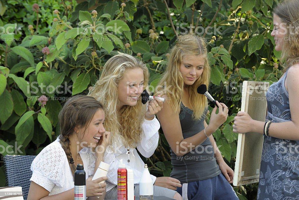 girls applying makeup royalty-free stock photo