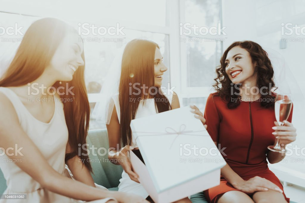 Girls Are Drinking Champagne Before Hen-Party. stock photo