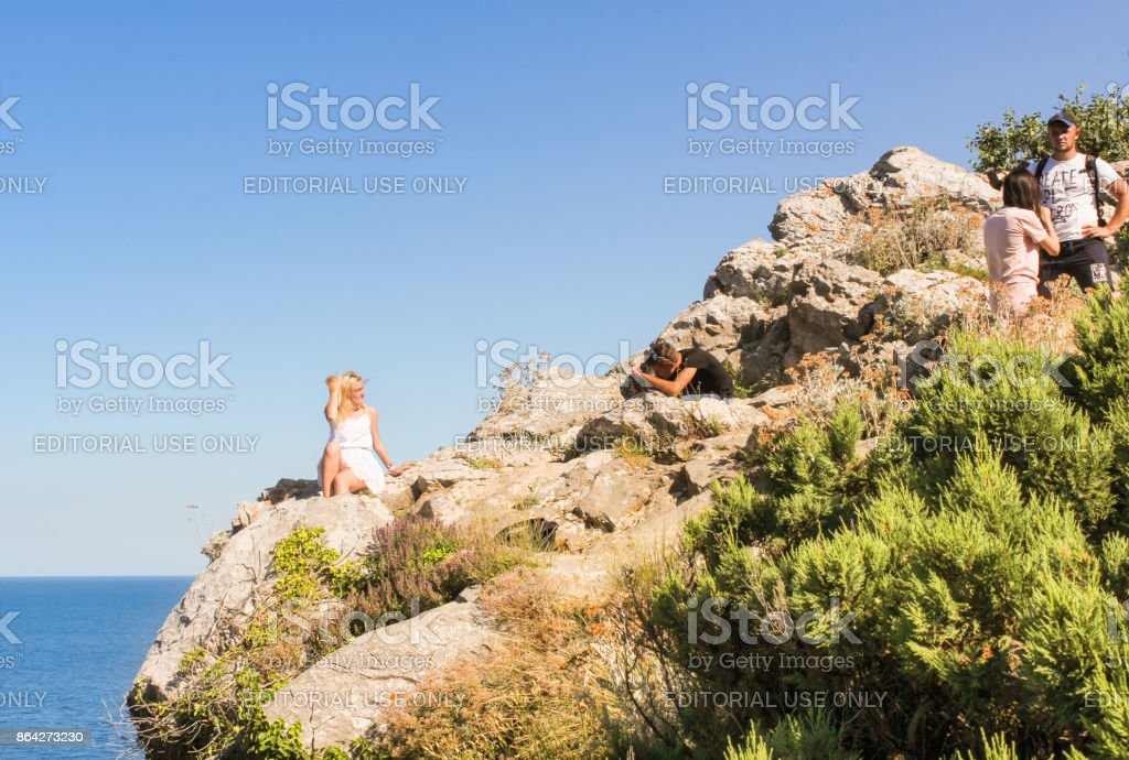 Girls are photographed at the cliff. royalty-free stock photo