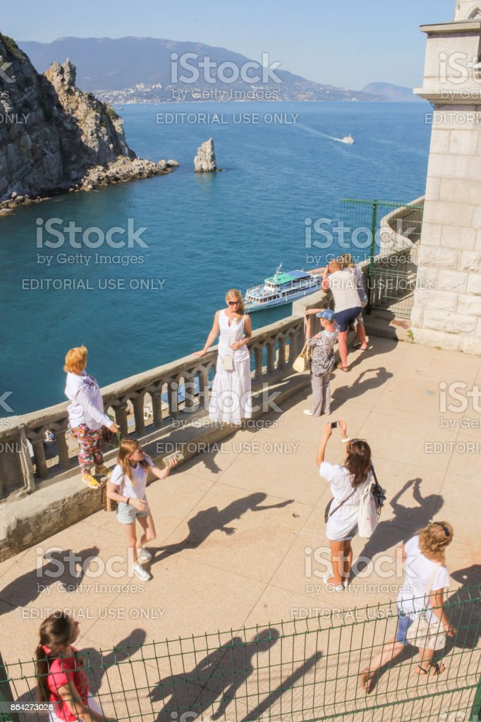 Girls are photographed at the railing. royalty-free stock photo