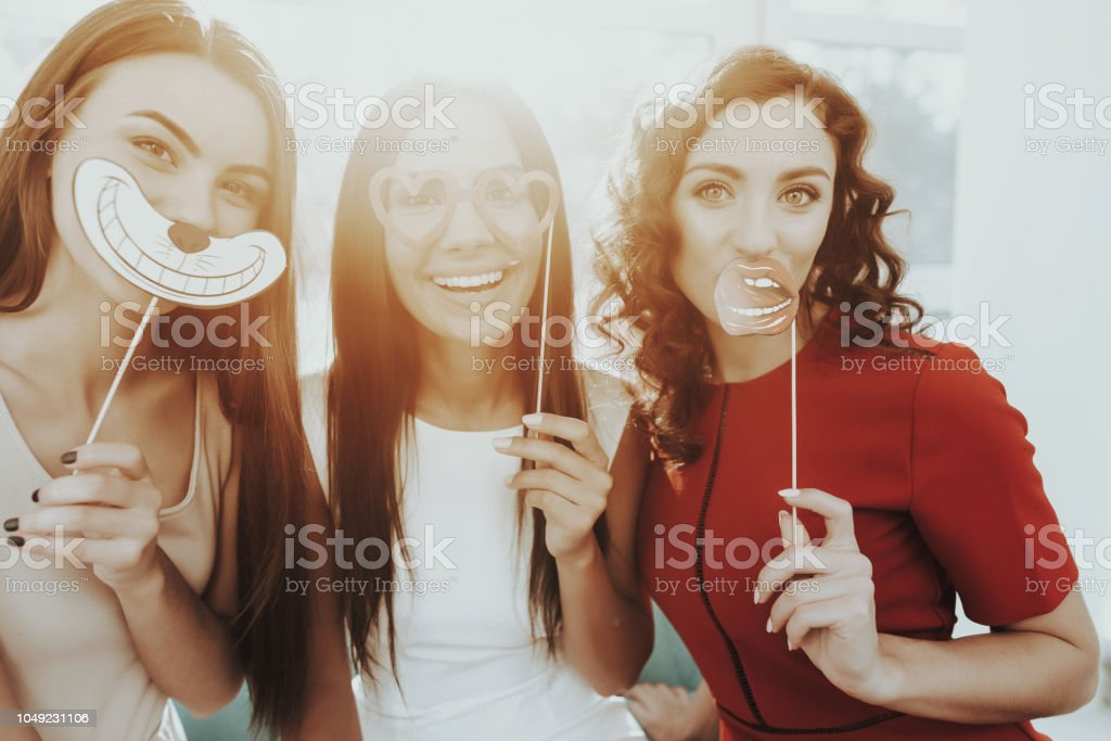 Girls Are Posing With Funny Figures On Hen-Party. stock photo