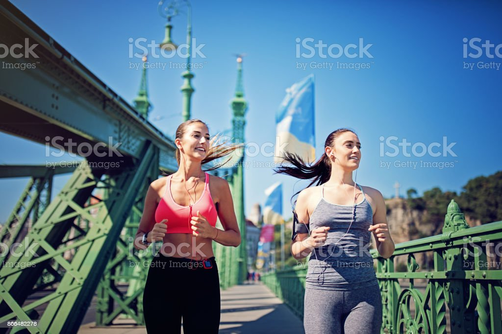 Girls are running on the bridge stock photo