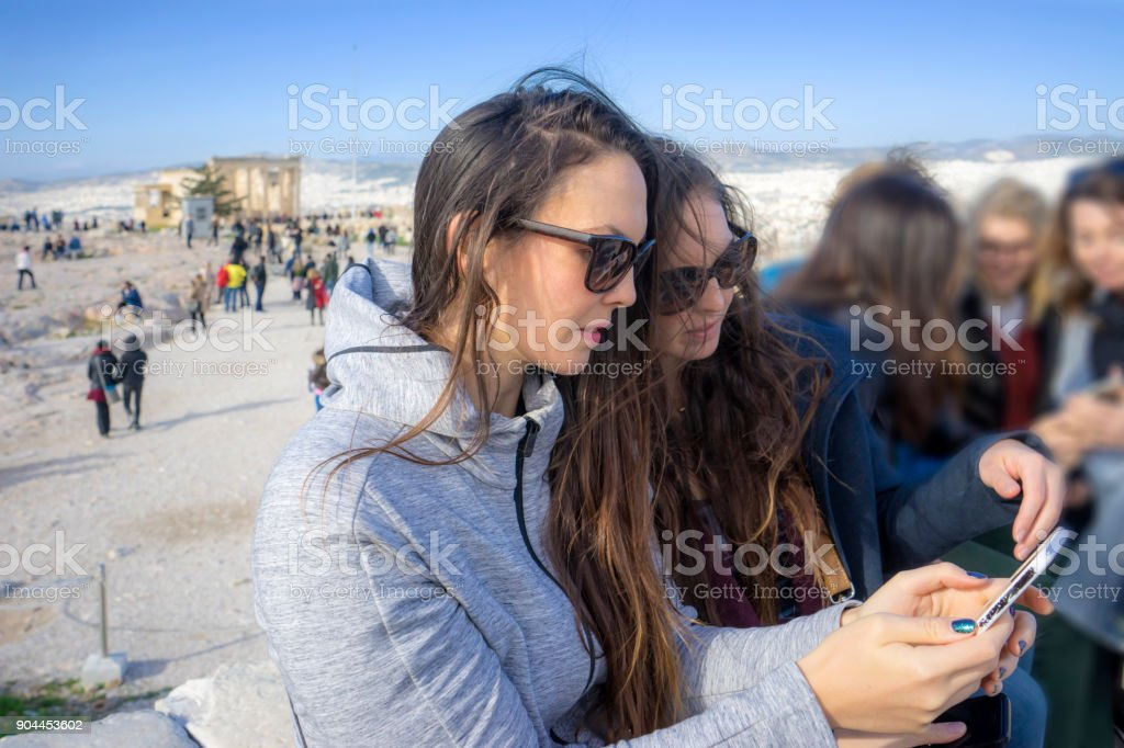 girls are taking photos stock photo