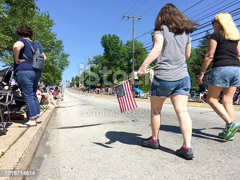 96695299 istock photo girls at july 4 parade 1219714814