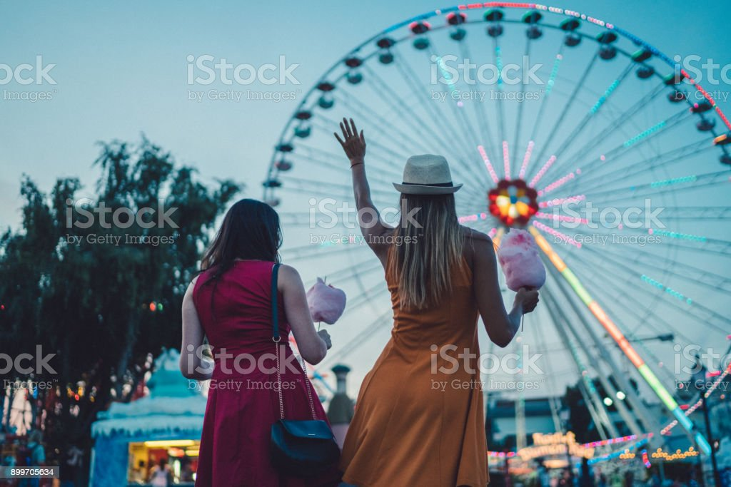 Girls at the amusement park stock photo