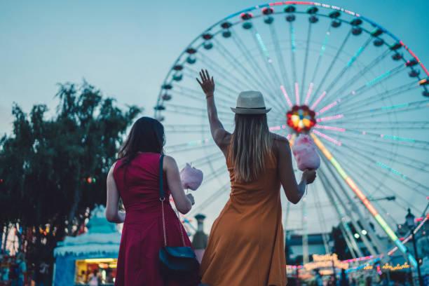 Girls at the amusement park stock photo