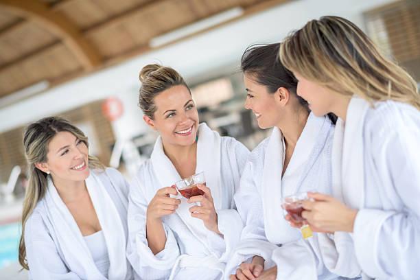 girls at the spa - damen umhänge stock-fotos und bilder