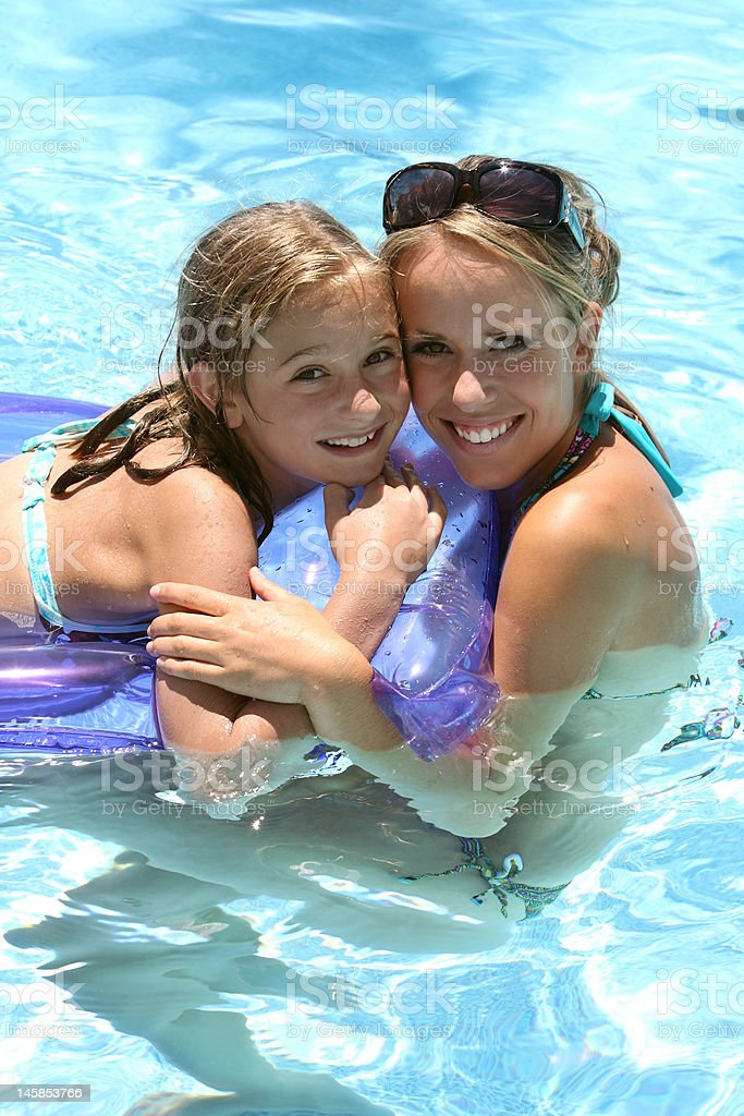 Girls at the swimming pool royalty-free stock photo