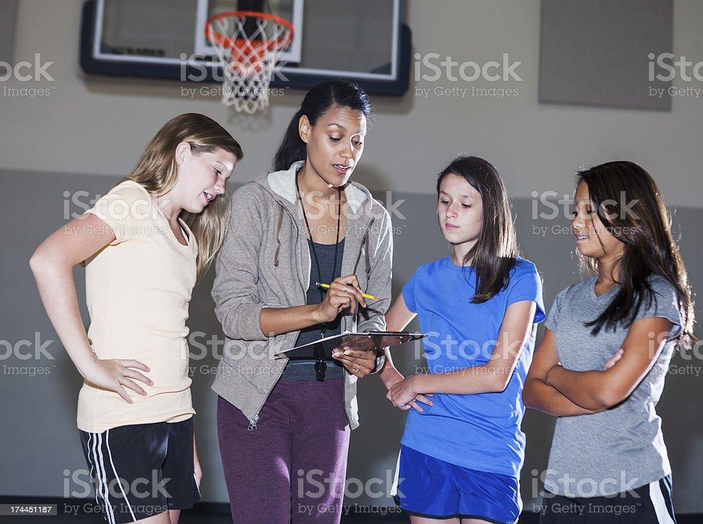 Girls' basketball coach stock photo