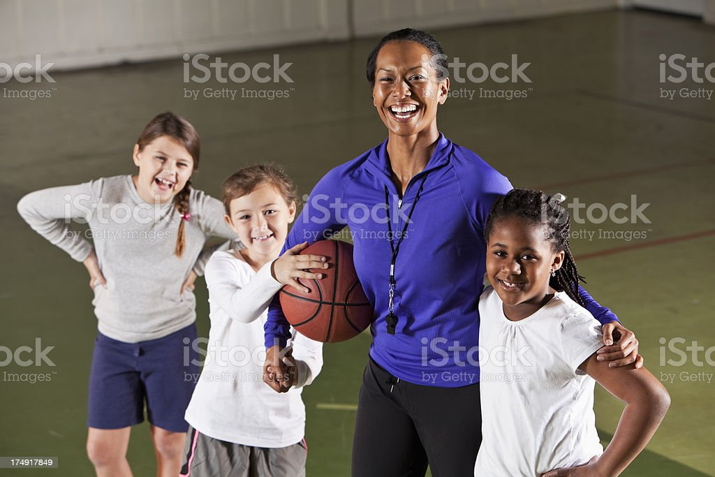 Girl's basketball team with coach royalty-free stock photo