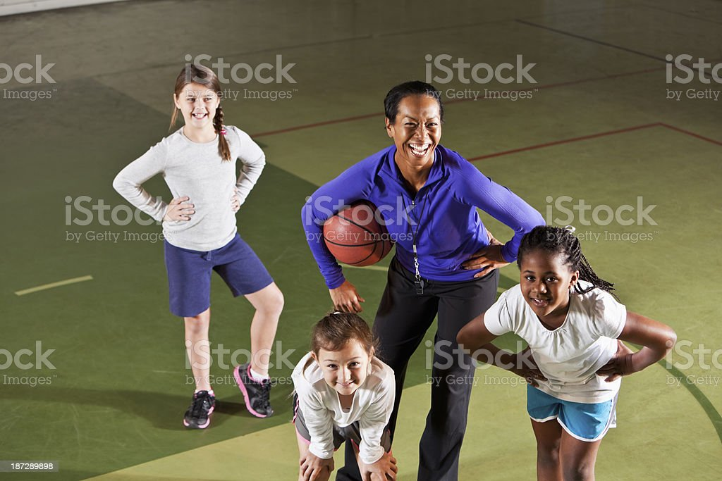 Girl's basketball team with coach stock photo